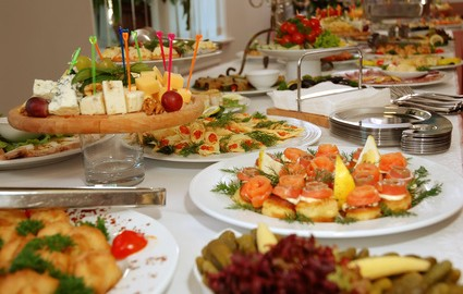 A banquet table filled with food.